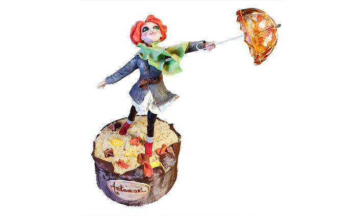 personaggio con ombrello realizzato in porcellana fredda per top torta autunnale