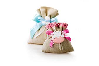 Bomboniere di stoffa con gessetti per neonati