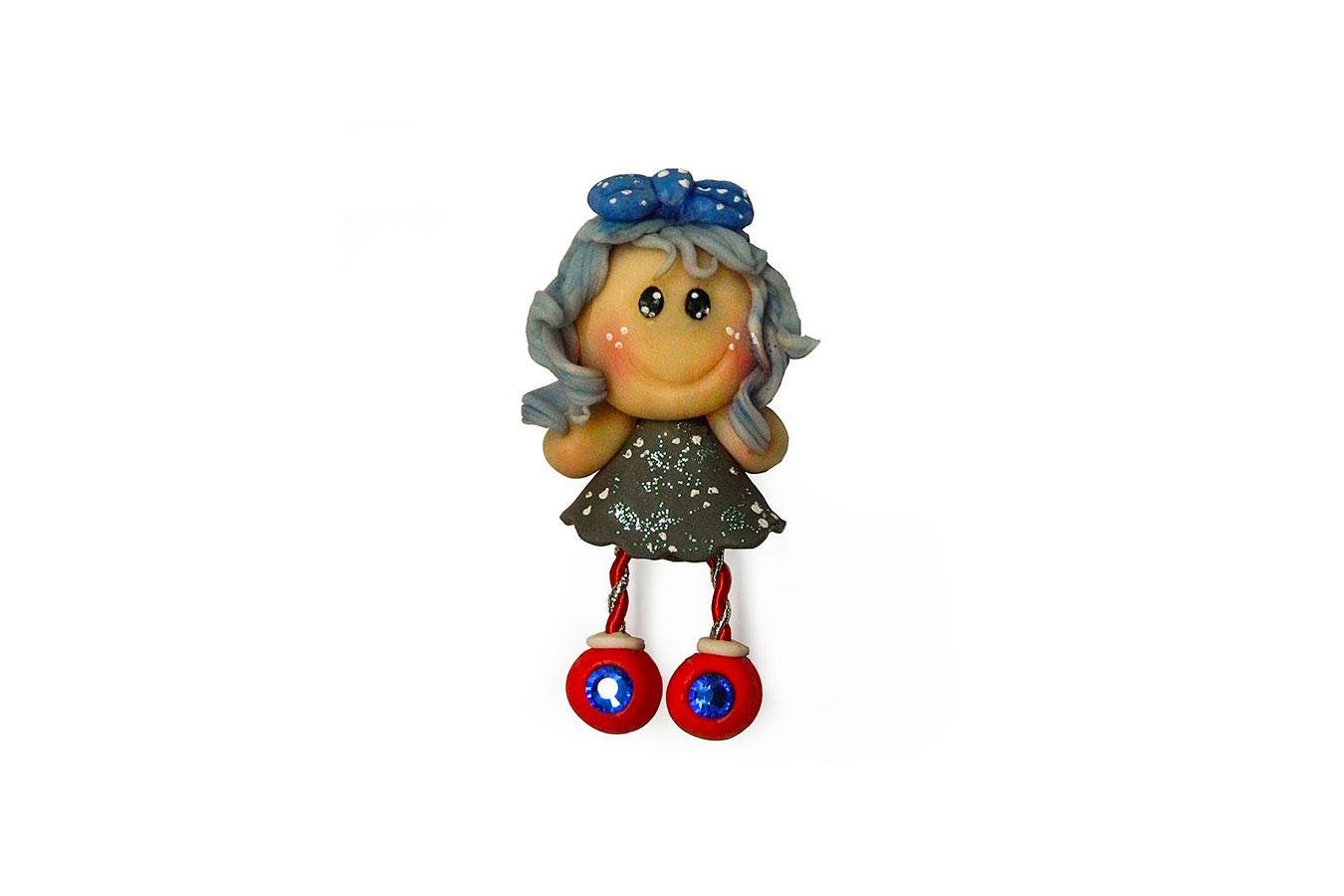 bambolina calamita con fiocco