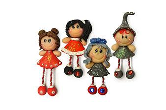 quattro bamboline calamite realizzata in porcellana fredda