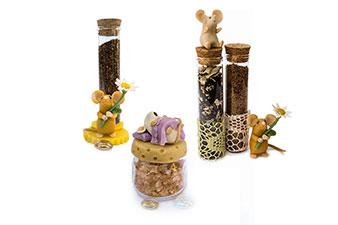 Confezioni di spezie in provette di vetro con topino in porcellana fredda